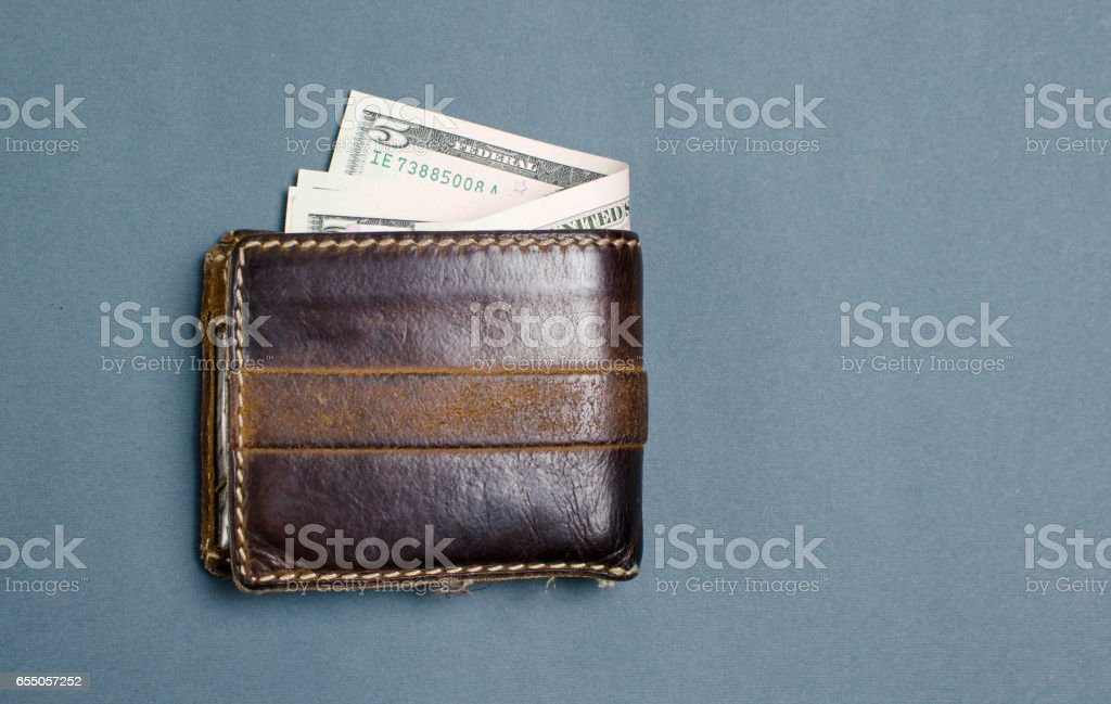 Dollar bills in brown leather wallet stock photo