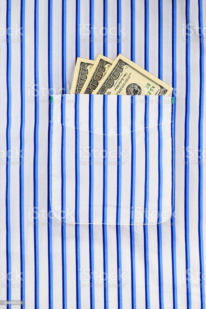 Dollar bills in pocket stock photo