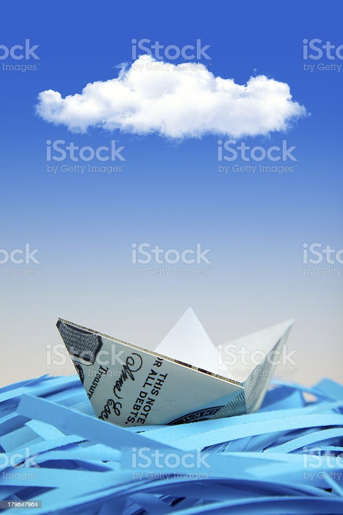 Dollar Boats on shredded paper royalty-free stock photo