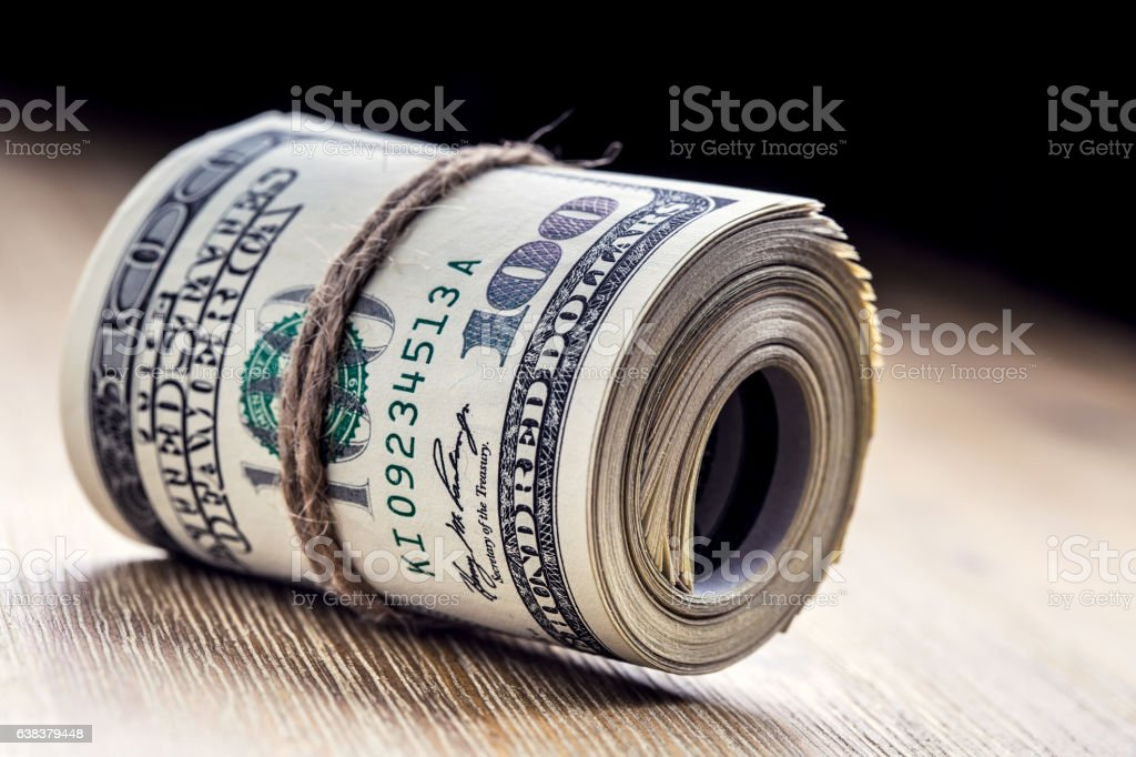 Dollar currency.Dollar banknotes rolled in other positions. stock photo