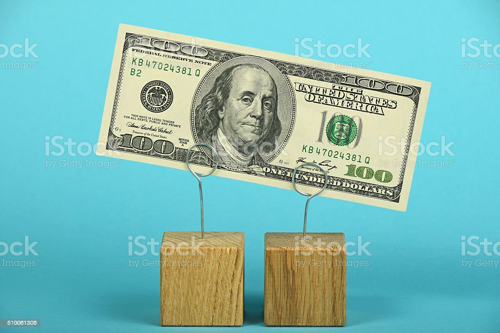 US dollar decline illustrated over blue stock photo