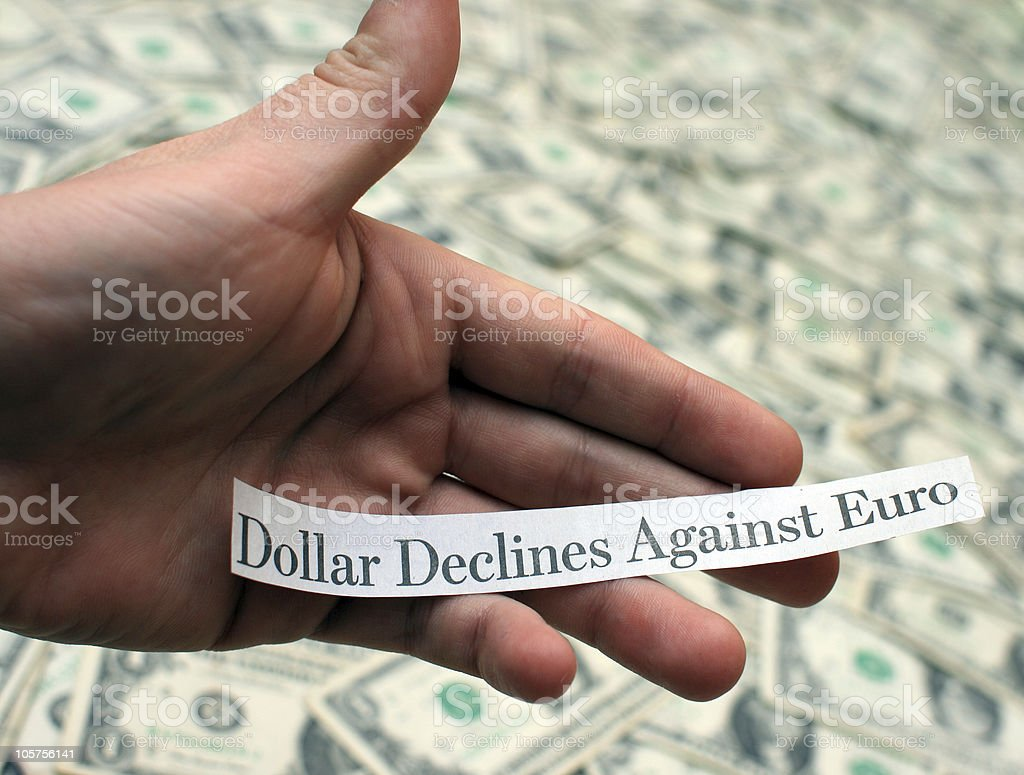 'Dollar Declines Against Euro' - Hand Holding Newspaper Headline royalty-free stock photo