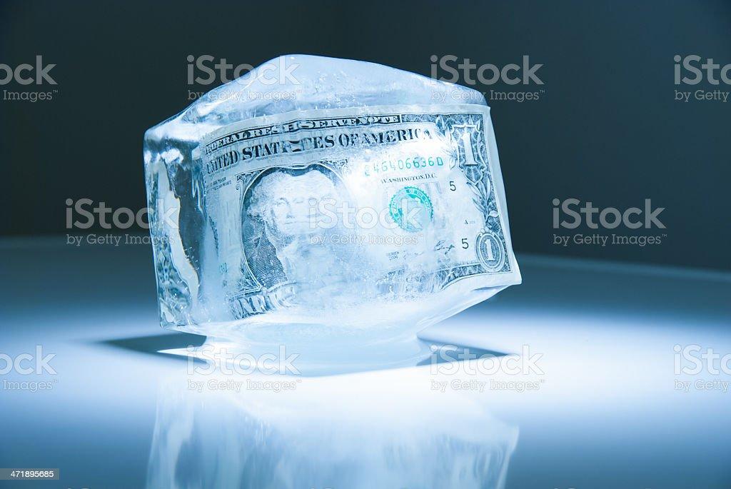 dollar in an ice cube stock photo
