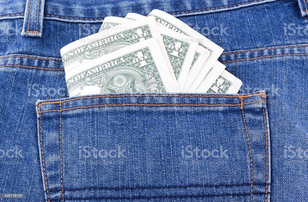 dollar in pocket stock photo