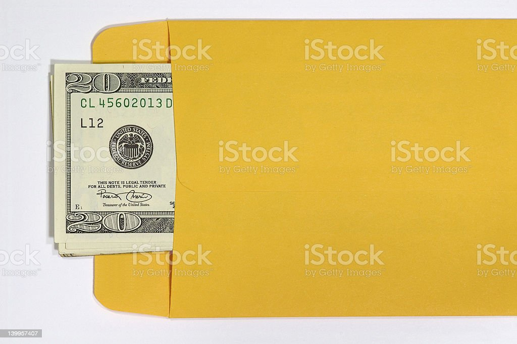 Dollar notes in yellow envelope stock photo