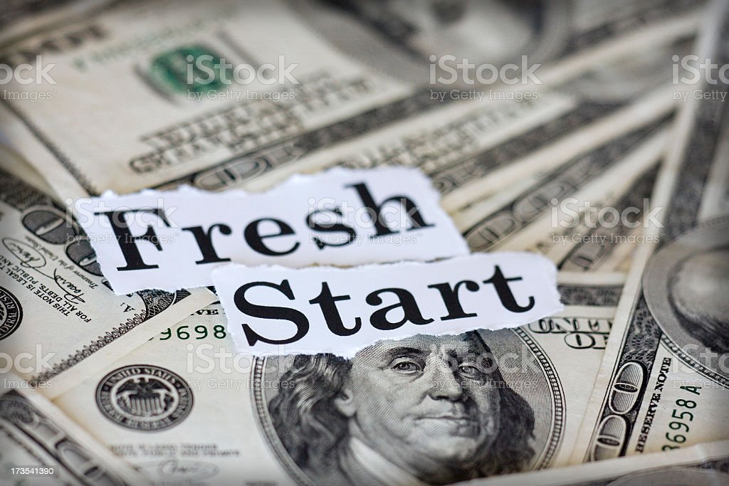 Dollar notes with fresh start text on top stock photo