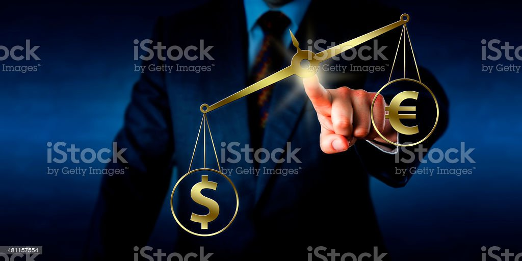 Dollar Outweighing The Euro On A Golden Balance stock photo