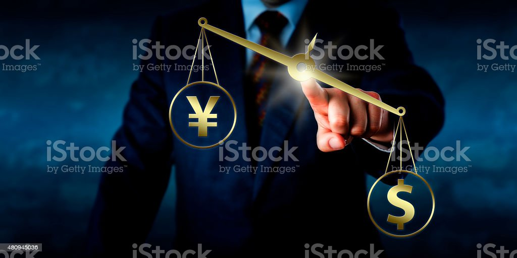 US Dollar Outweighing The Yuan On A Golden Scale stock photo