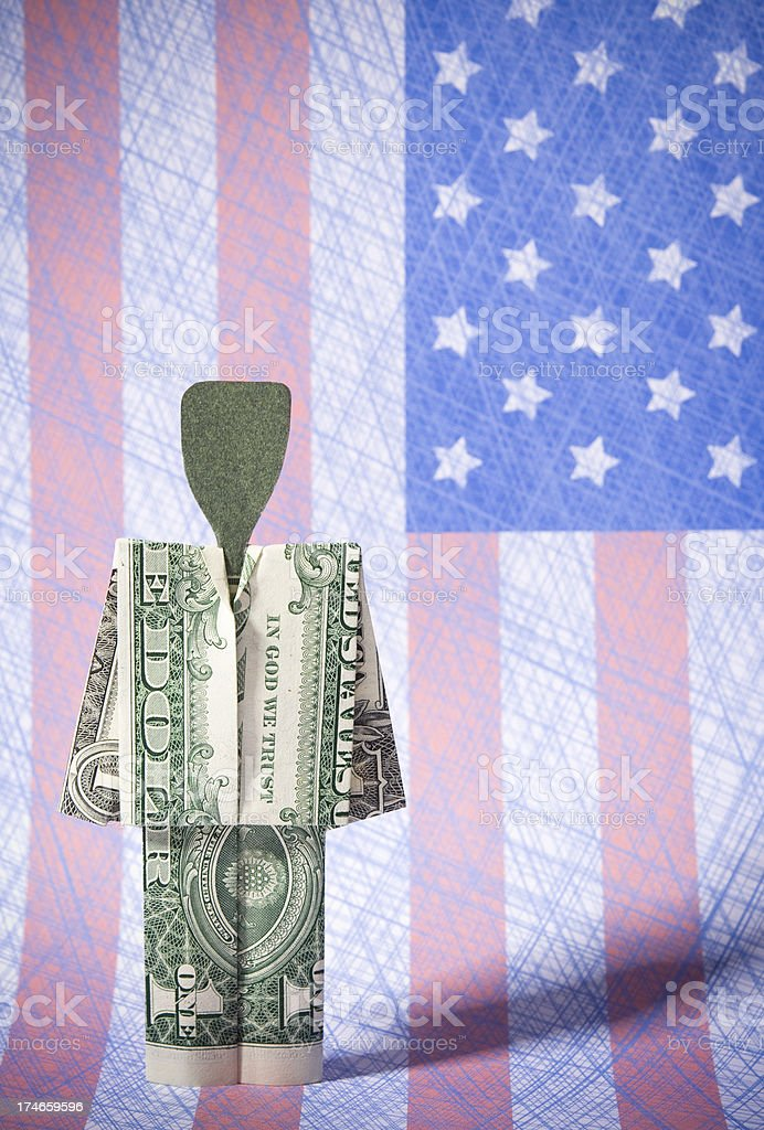 Dollar person on American Flag royalty-free stock photo