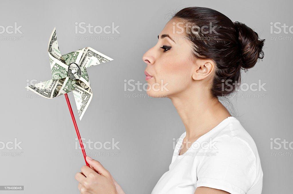 Dollar pinwheel to businesswoman royalty-free stock photo