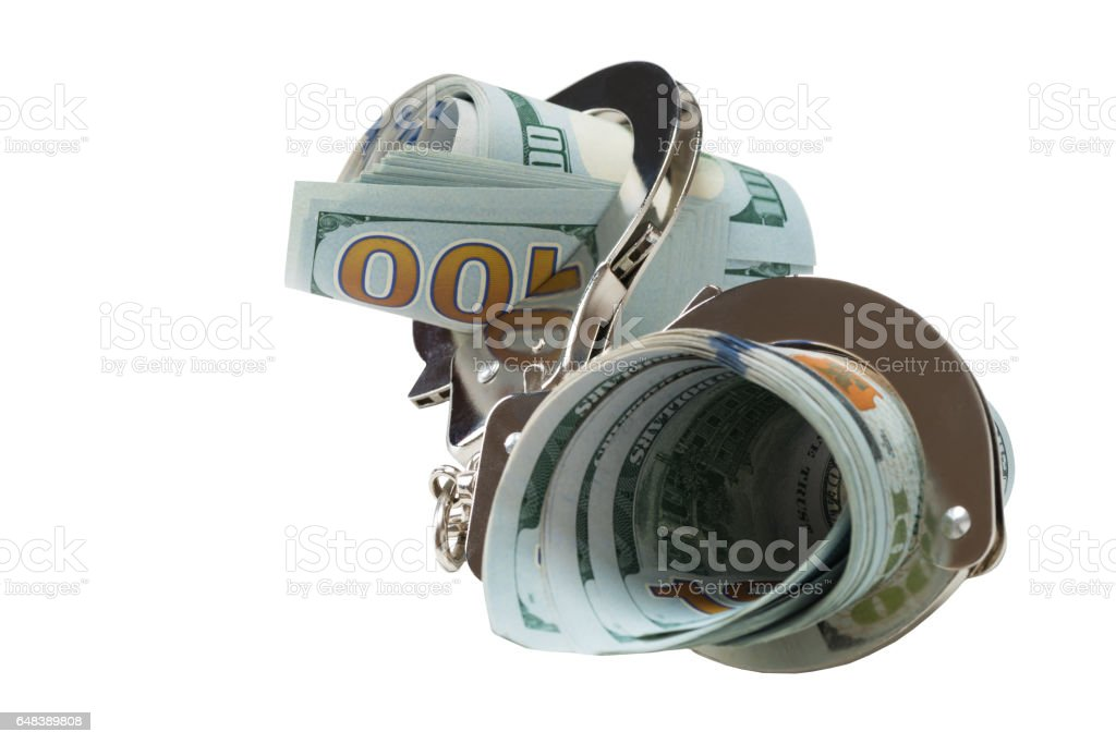 dollar rolls of are closed in handcuffs on a white background stock photo