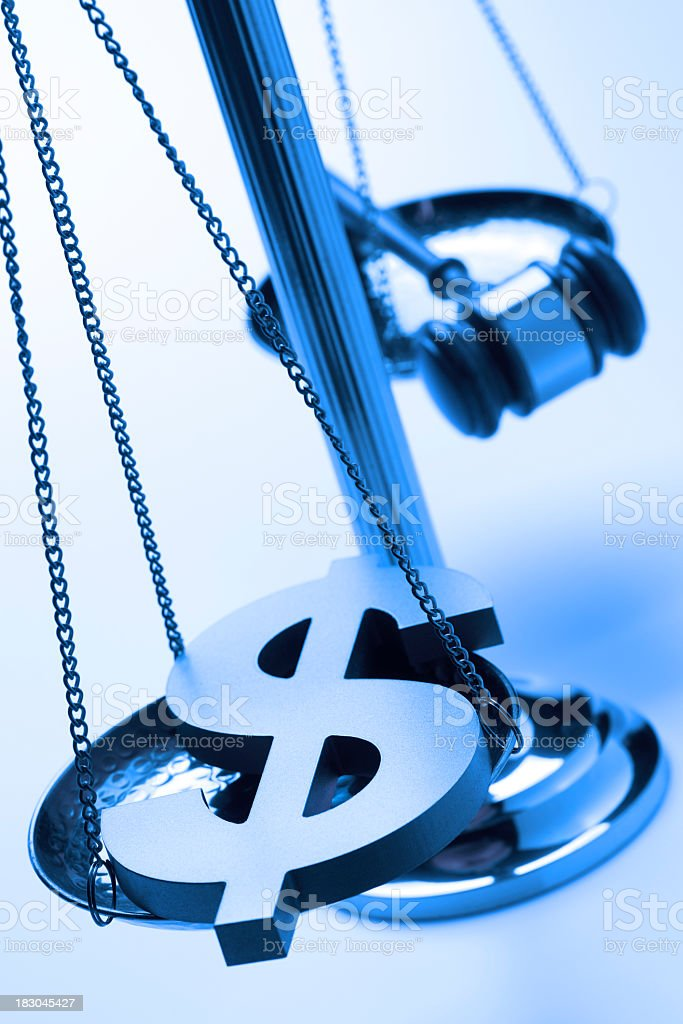 Dollar sign and gavel on justice scale royalty-free stock photo