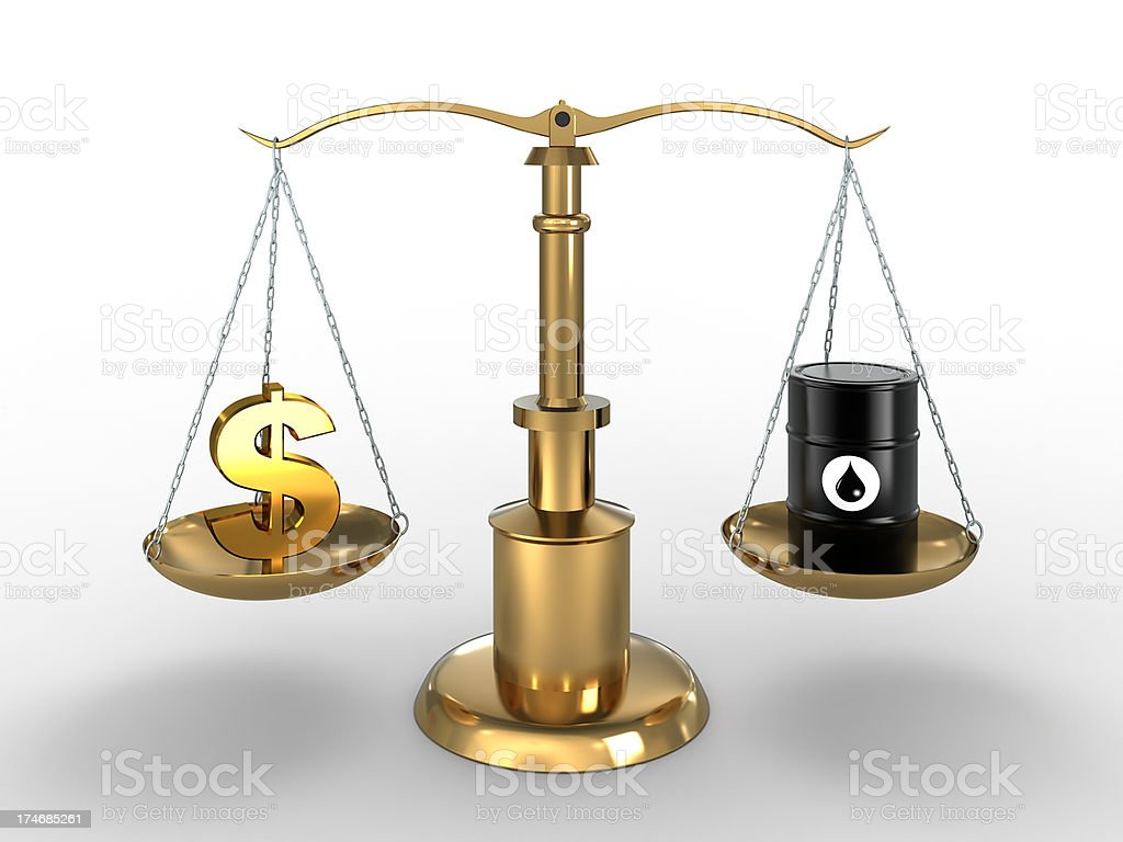 Dollar sign and Oil Barrel in balance (Clipping path included) stock photo