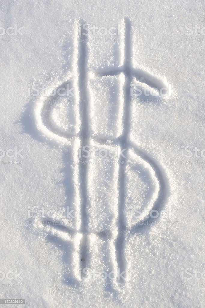 Dollar Sign Currency Symbol in Snow Representing Frozen Assets stock photo