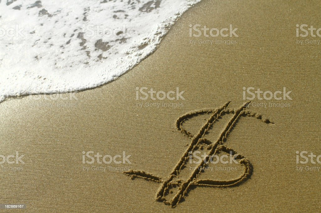 Dollar sign on the beach royalty-free stock photo