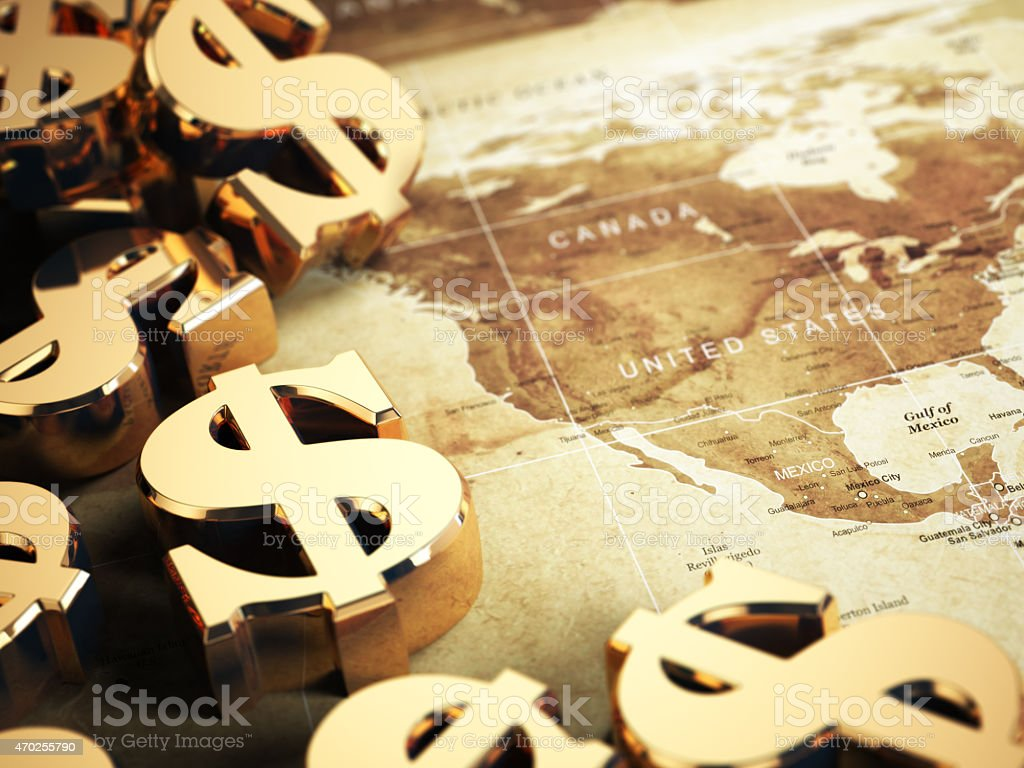 Dollar sign on the world map background with DOF effect. stock photo