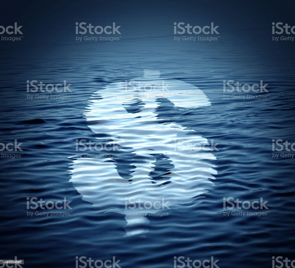 Dollar symbol drifts on the water. Economic crisis concept. stock photo