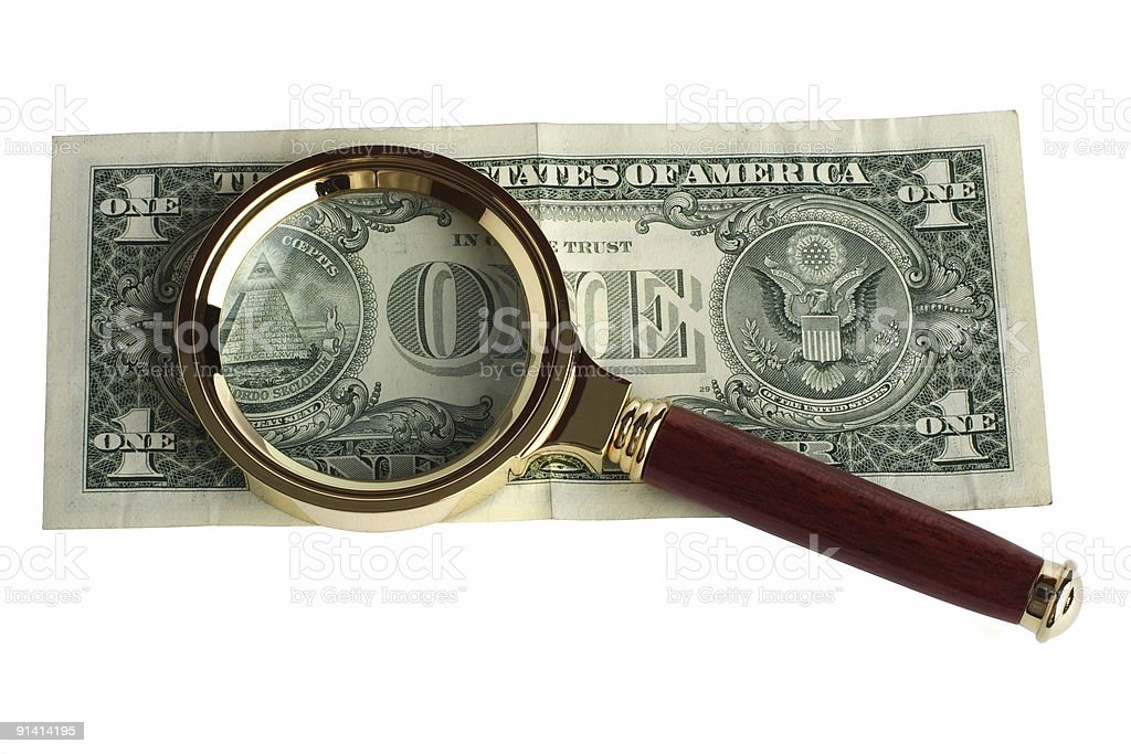 Dollar under a magnifier stock photo
