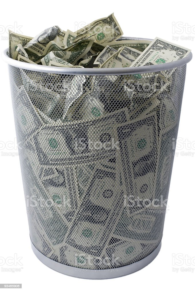 US dollar USD $ trash - US economy trashcan concept stock photo