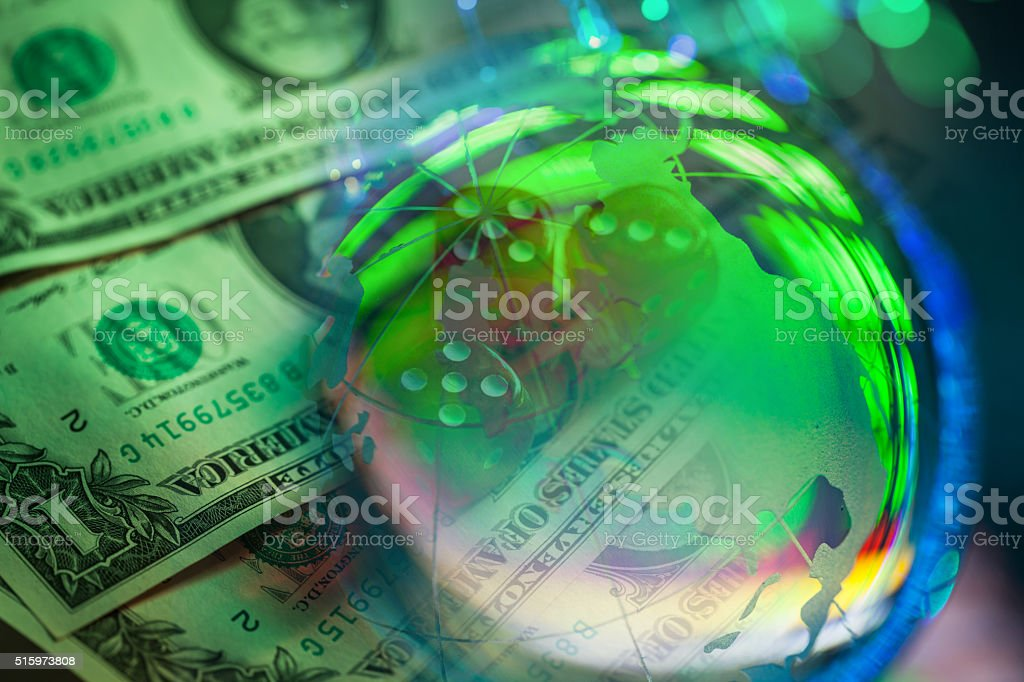dollar with dices and global crystal ball stock photo