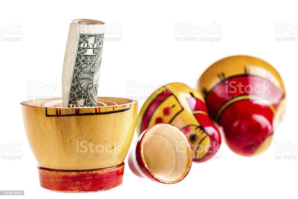 Dollar within Matryoshka doll royalty-free stock photo