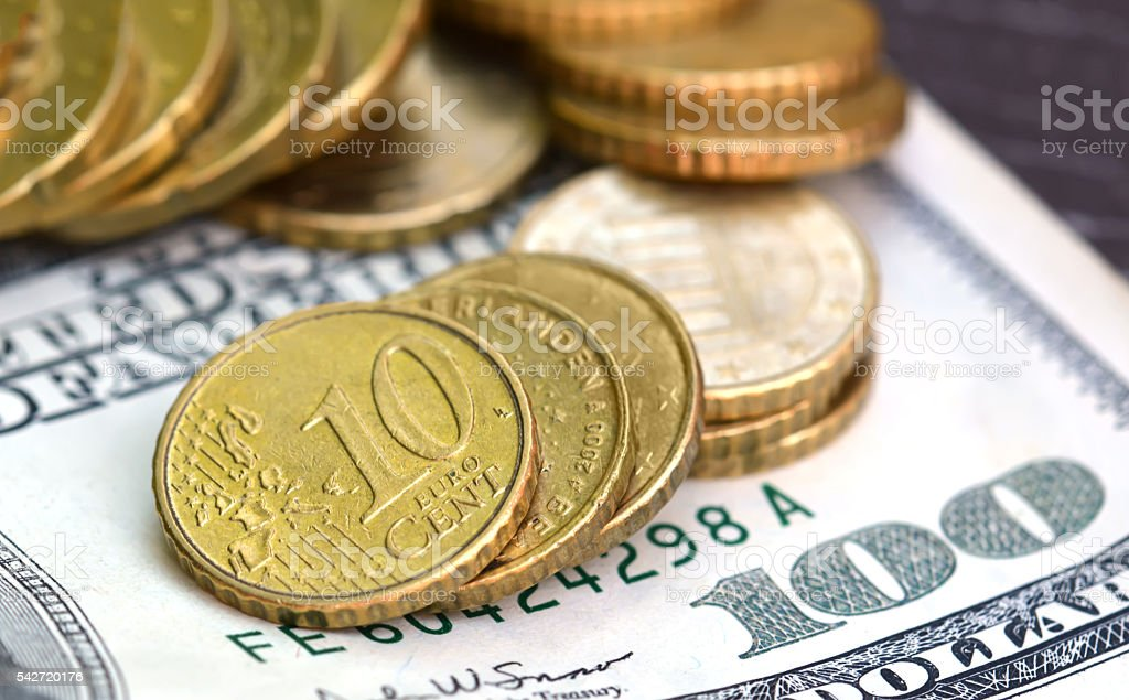 100 $ dollars and 10 cent coins. Macro image stock photo