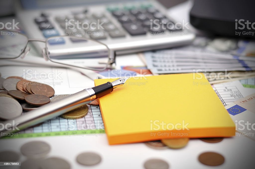 dollars and calculator stock photo