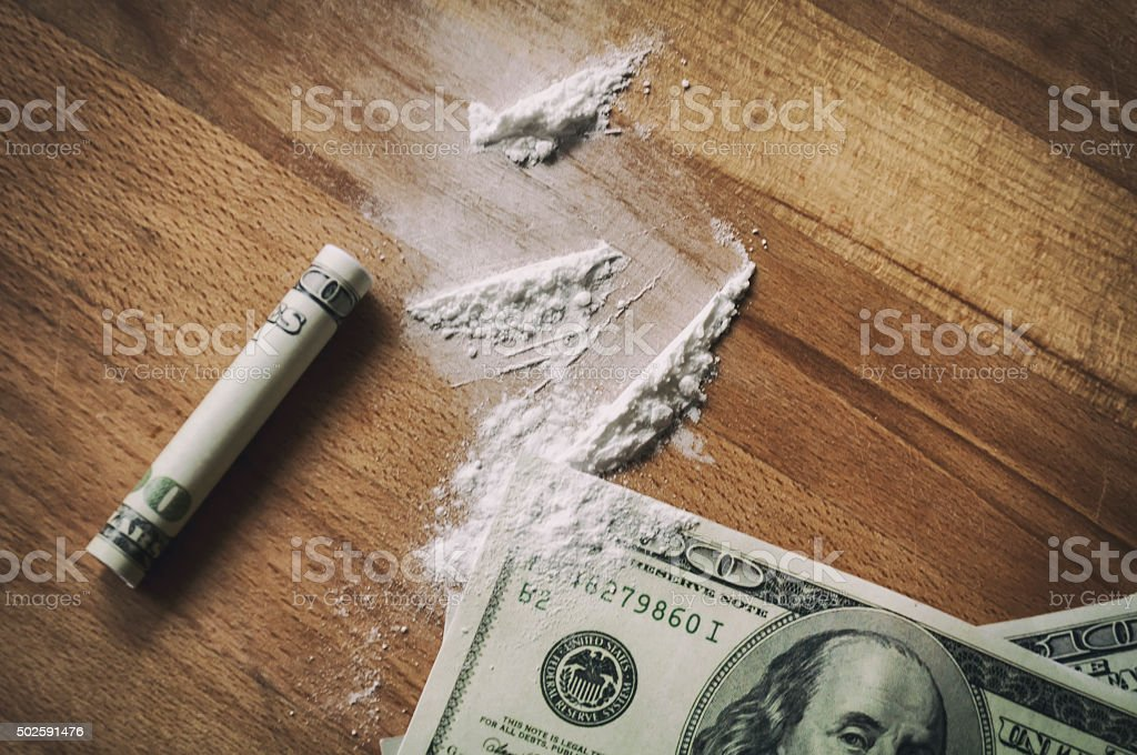 dollars and cocaine stock photo