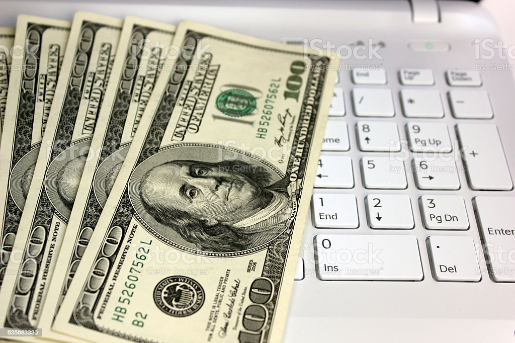 Dollars and computer stock photo