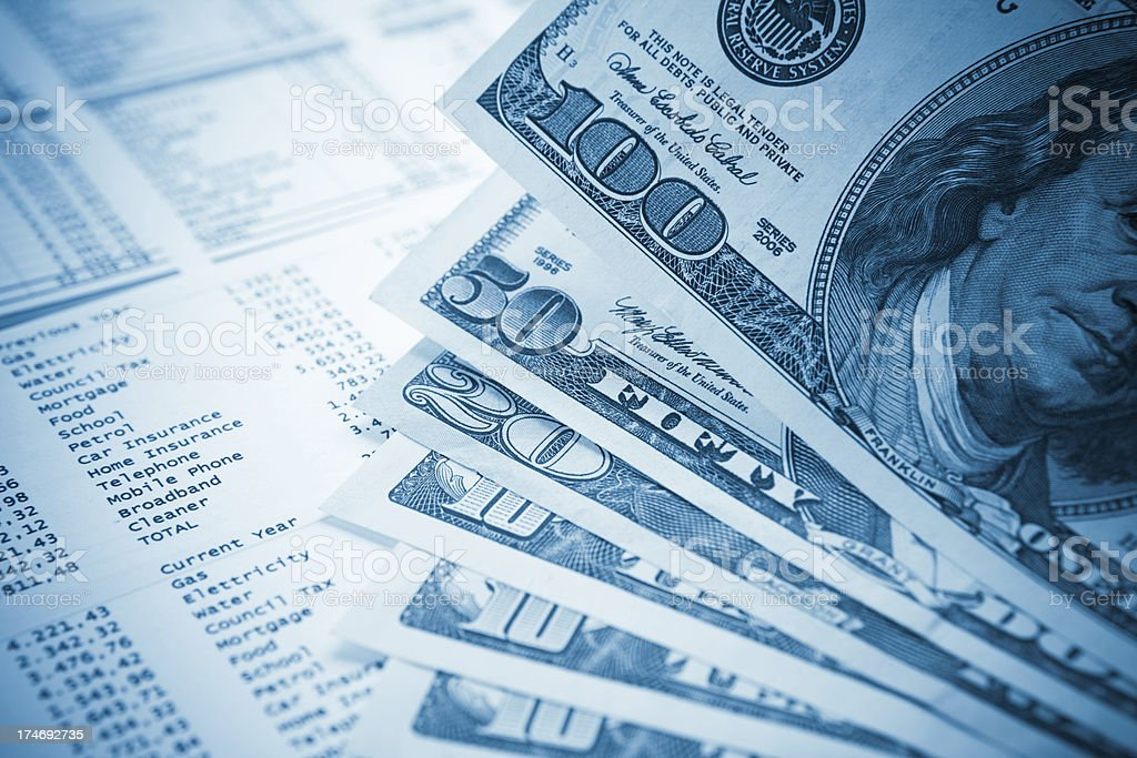 Dollars and financial document close-up stock photo