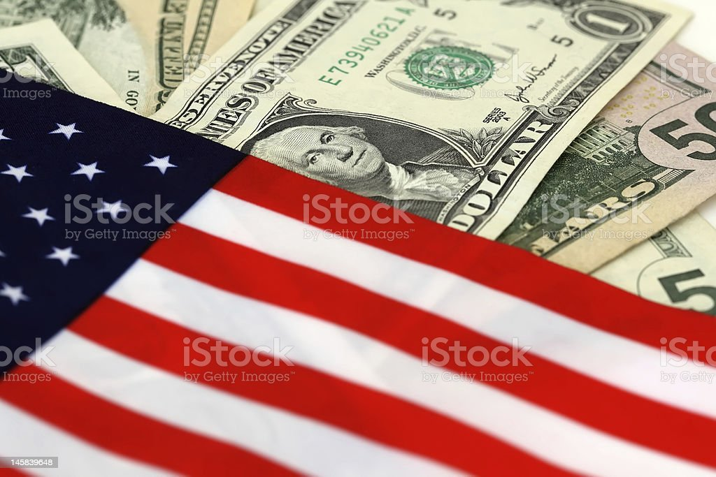 Dollars and flag stock photo