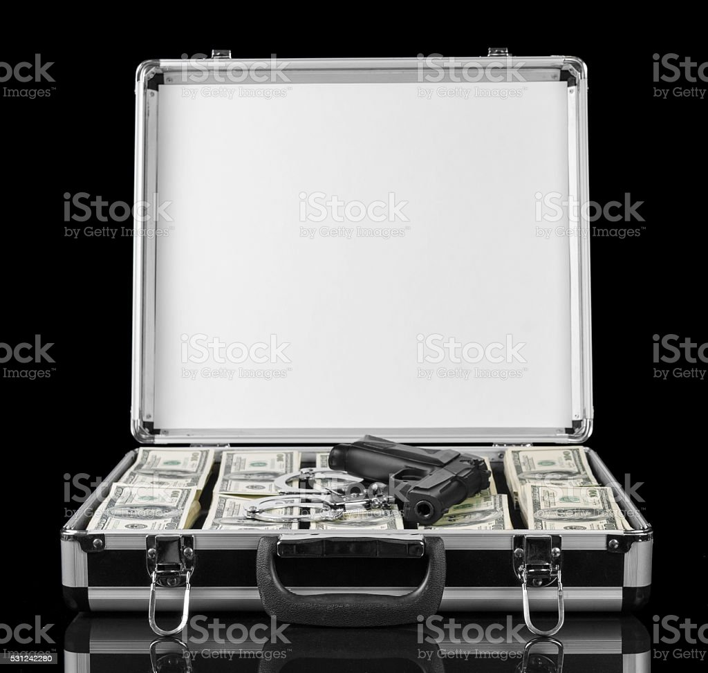Dollars and gun in case isolated on a black stock photo