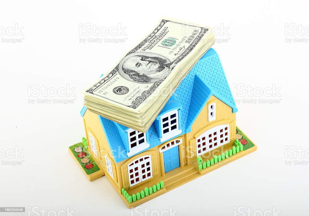 Dollars and house royalty-free stock photo