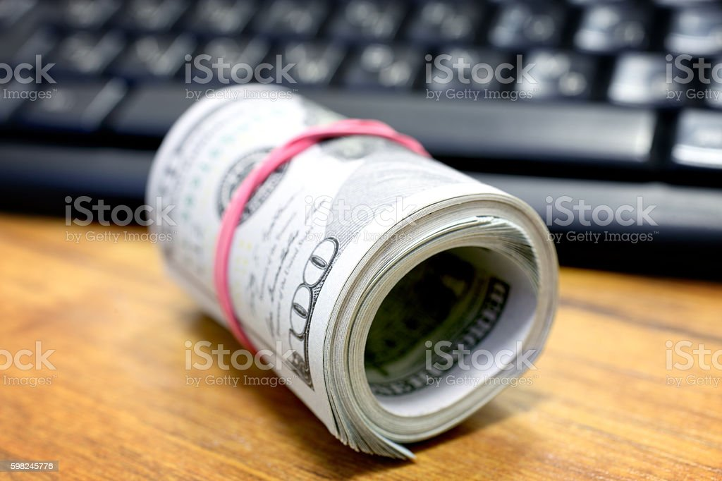 Dollars and keyboard stock photo