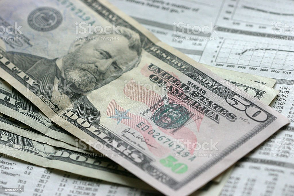 Dollars and newspaper royalty-free stock photo