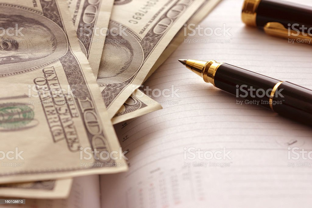 Dollars and pen royalty-free stock photo
