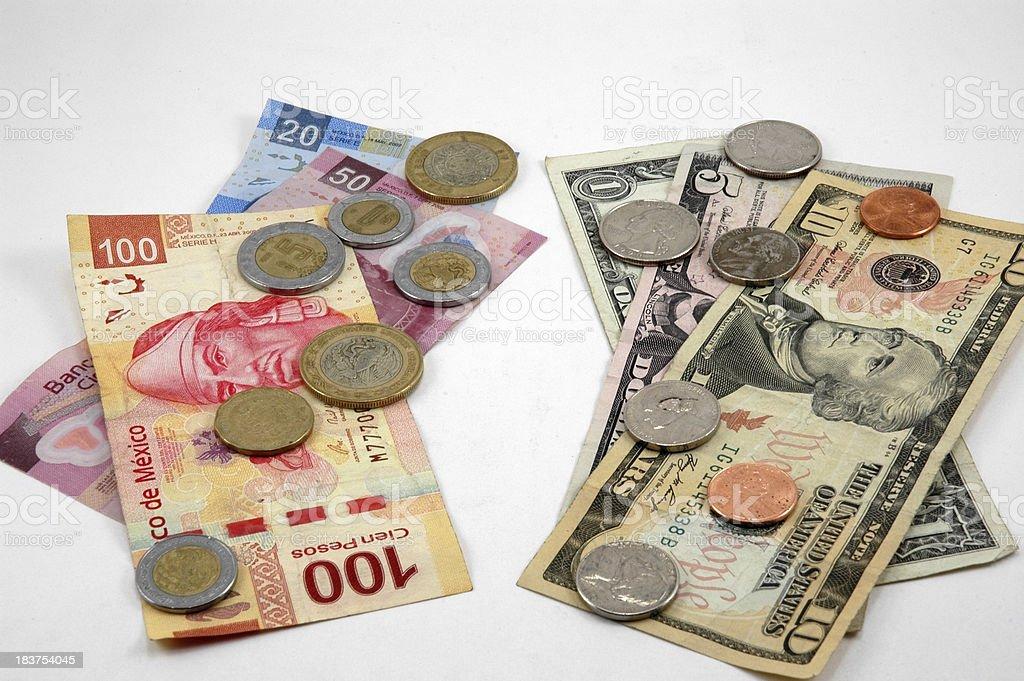 Dollars and Pesos stock photo