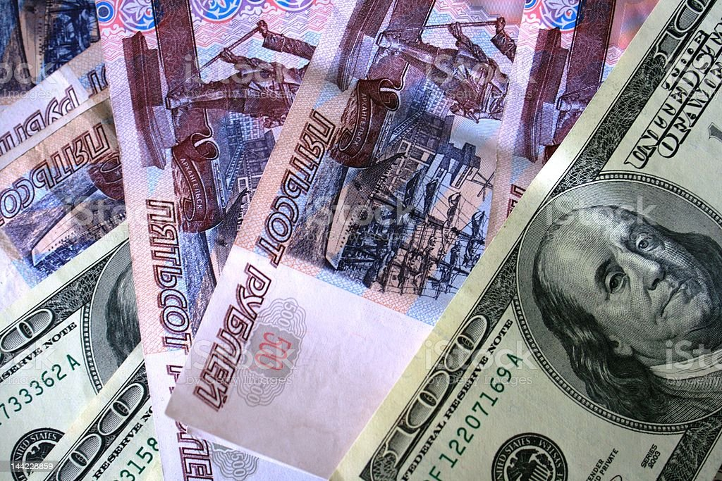 US dollars and Russian roubles banknotes royalty-free stock photo