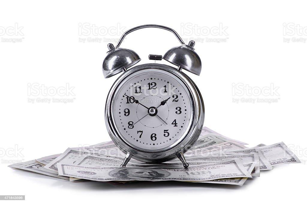 dollars banknotes and clock stock photo