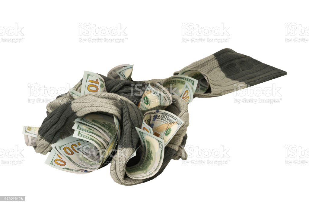 dollars entangled in a soft scarf on a white background stock photo