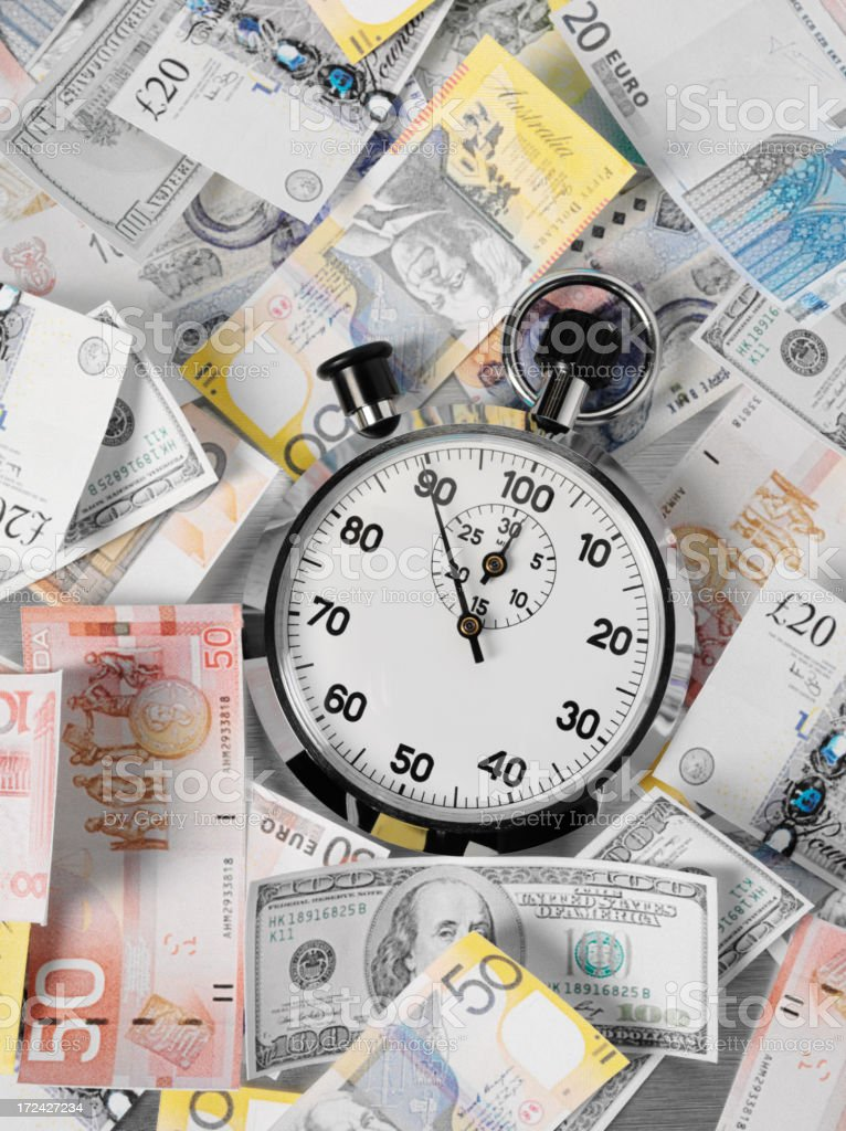 Dollars, Euro and Pounds with a Stopwatch royalty-free stock photo