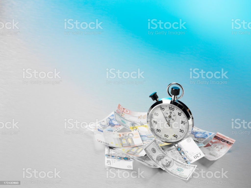 Dollars, Euros and Pounds on Stainless Steel with a Stopwatch royalty-free stock photo