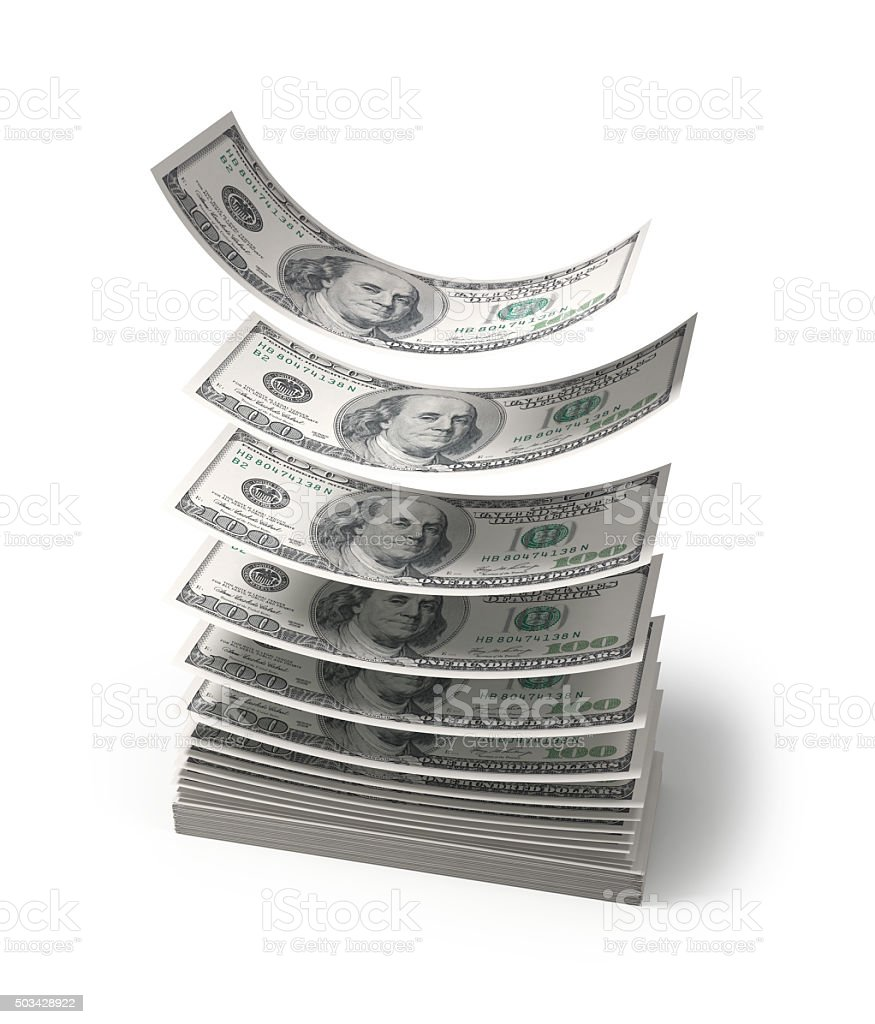 Dollars falling to the stack of dollars stock photo