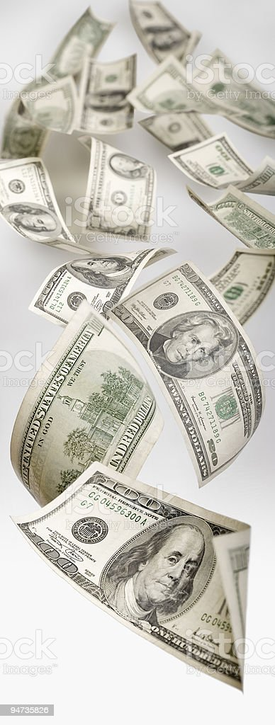Dollars flying through the space stock photo