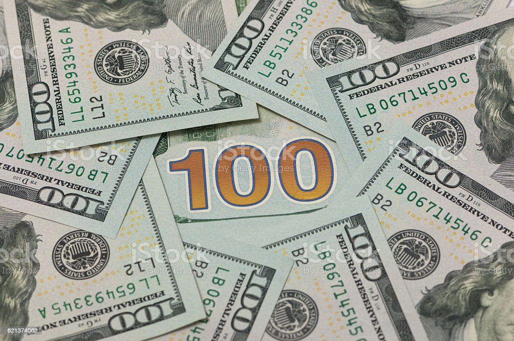 100 dollars in a circle stock photo