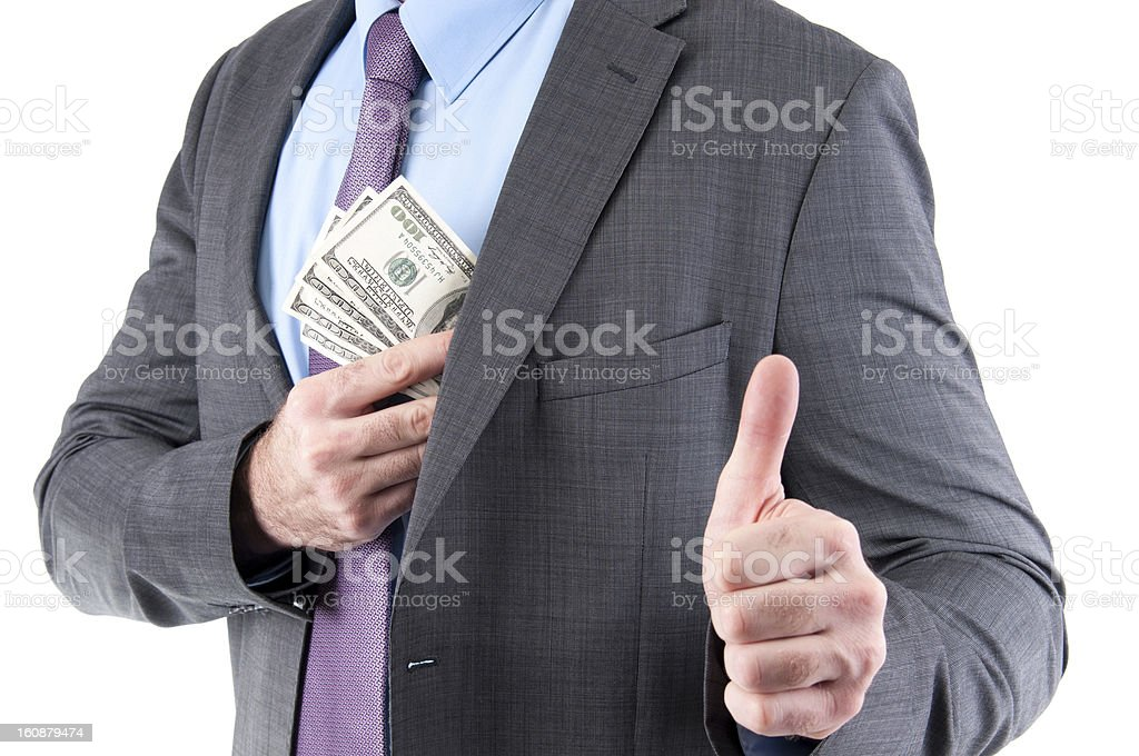 Dollars in a pocket of corrupted businessman showing thumb up stock photo