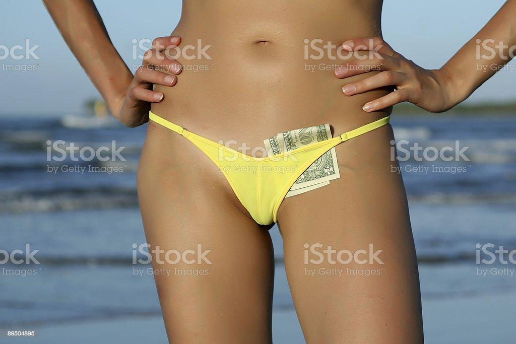 Dollars in bikinis royalty-free stock photo