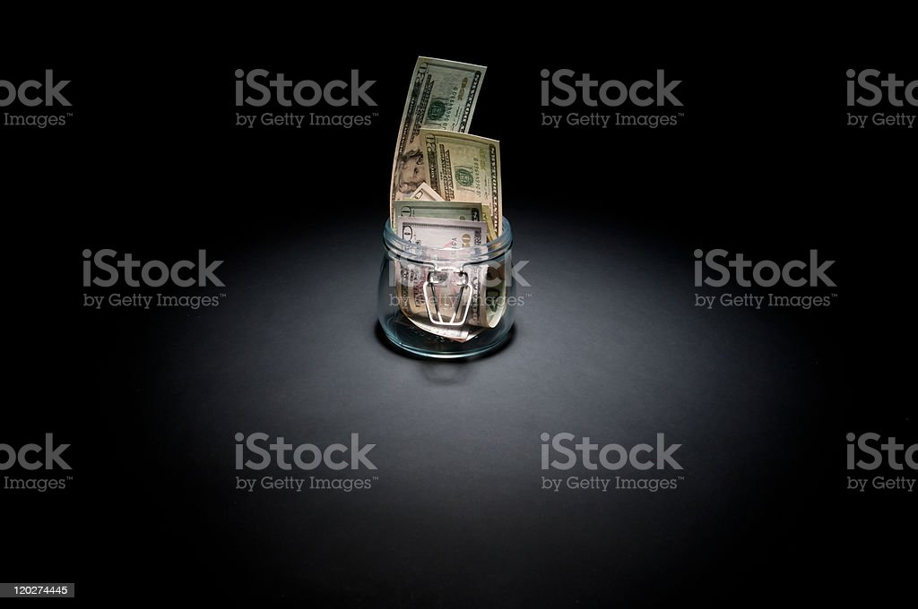 Dollars in glass jar royalty-free stock photo