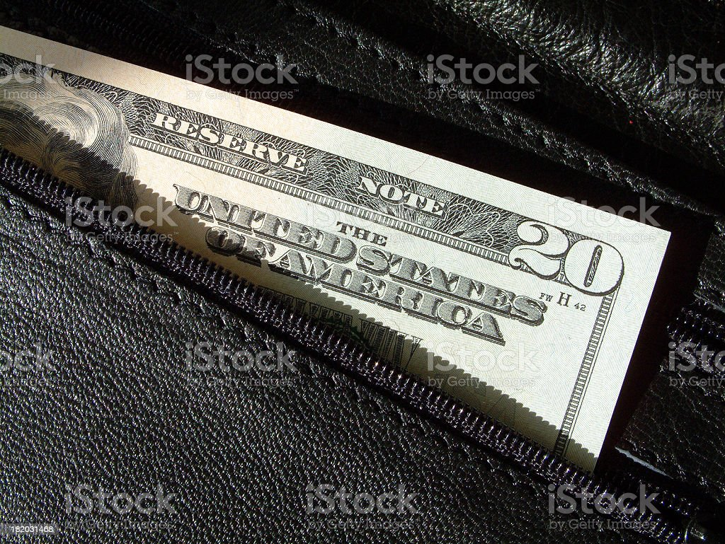US dollars in leather wallet stock photo