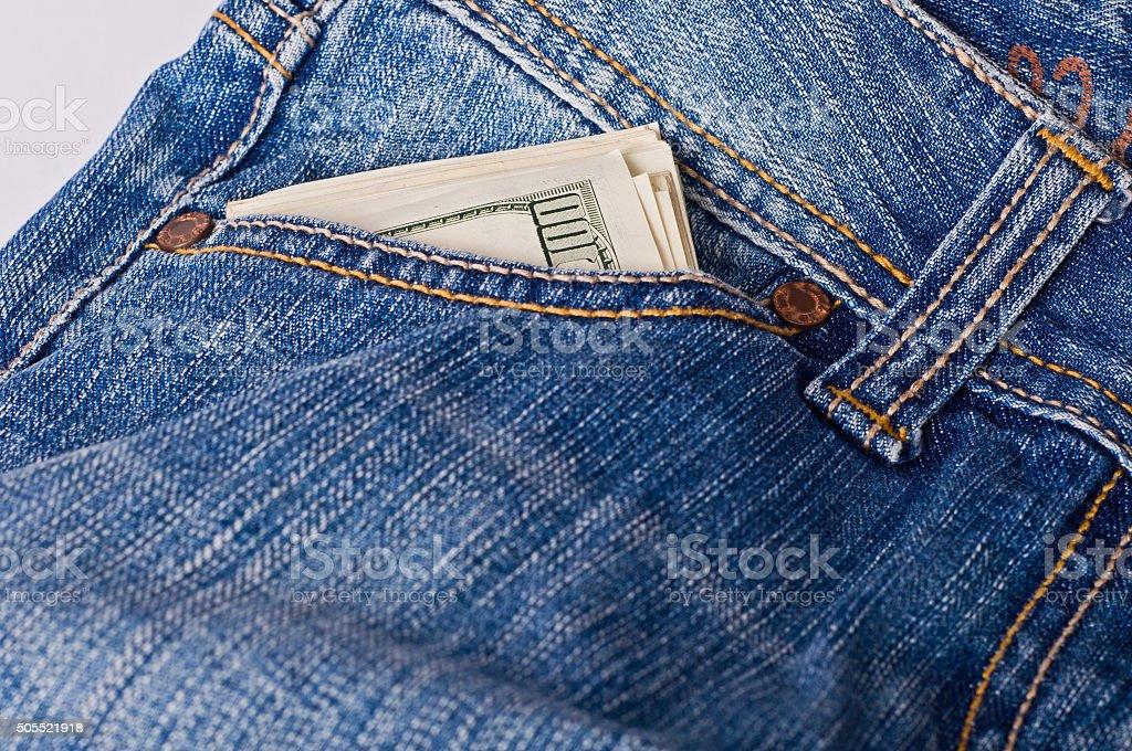 Dollars in pocket stock photo